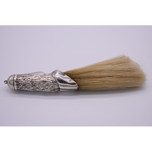 39 - <strong>A Victorian silver mounted crumb brush, </strong>by<em>Cornelius Desormeaux Saunders & ...
