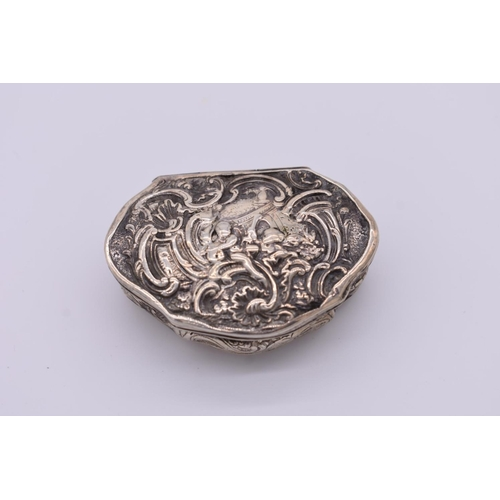40 - <strong>A Dutch white metal repousse snuff box,</strong> 6cm wide....