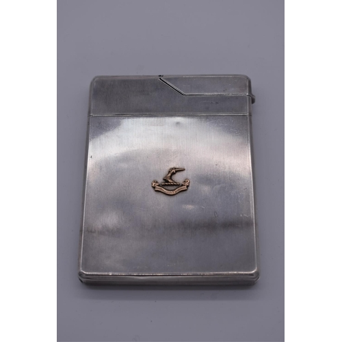 41 - <strong>An engine turned silver combination cigarette case and lighter</strong>, by<em>Asprey &...