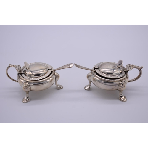 44 - <strong>A pair of silver mustards</strong>, by <em>Horace Woodward & Co Ltd , </em>London 1910, ...