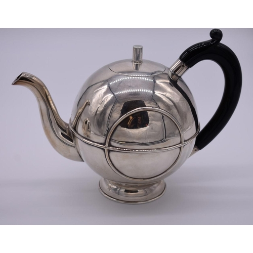 6 - <strong>A Scandinavian Art Deco style three piece teaset</strong>, stamped .925, 977g all in....