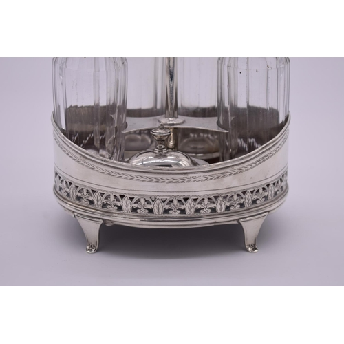 9 - <strong>A George III silver condiment stand</strong>, probably by <em>William Abdy II</em>, London 1...