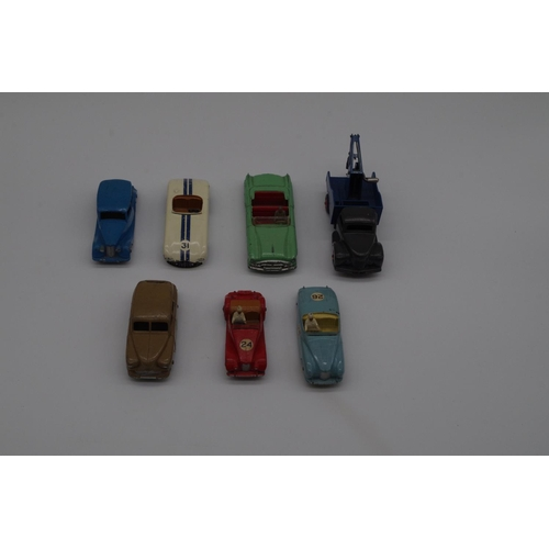 1596 - <strong>Dinky Toys:</strong>a collection of seven vintage diecast vehicles, comprising: Red MG Midg...