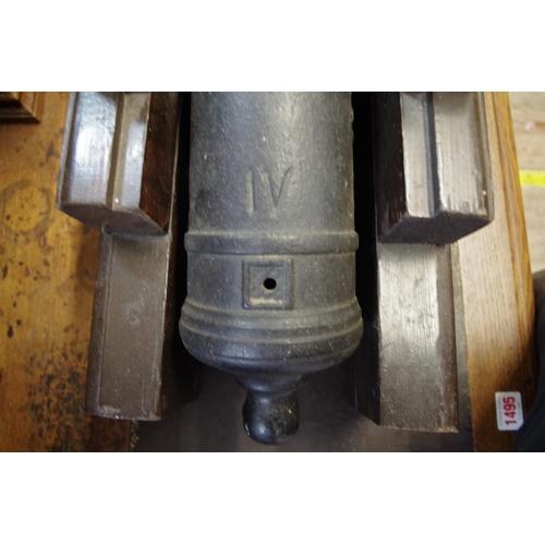1780 - <strong>A reproduction cast iron cannon,</strong> on wooden carriage, barrel length 48cm, (non-firea...