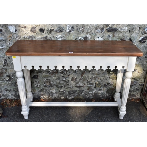 1000 - A modern cream painted hall table, 122cm wide. <strong>This lot can only be collected on Saturday 5t...