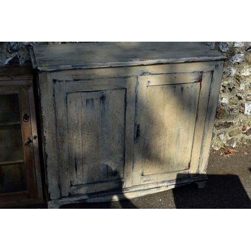 1001 - A painted wood two door cupboard, 103cm wide; together with a stripped pine glazed two door cupboard...