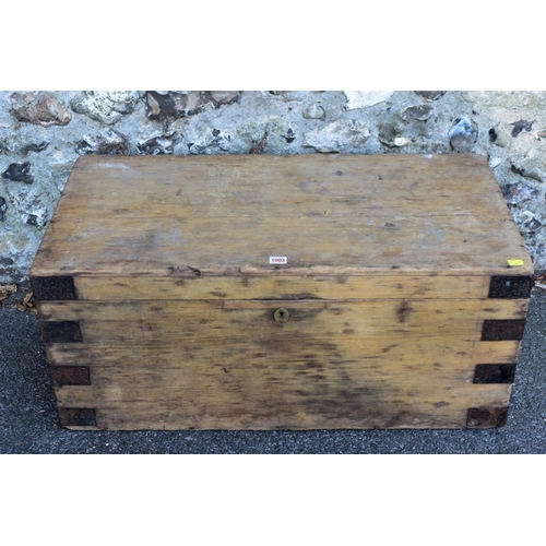 1003 - A stripped pine trunk, having iron loop handles, 91cm wide x 40cm high, together with a smaller pine...