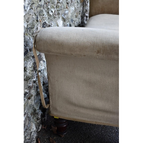 1005 - A Victorian window or hall seat having scroll arms on turned legs, 164cm wide x 74cm high to arm. <s...