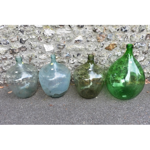 1018 - Four various glass carboys.<strong>This lot can only be collected on Saturday 5th September (1...