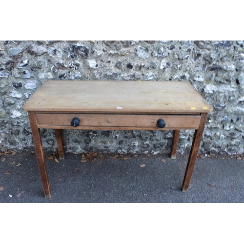 1019 - A Victorian mahogany tea table, 76cm wide; together with a rectangular pine table having one long dr...