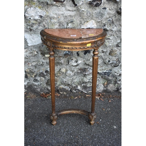 1021 - A small 18th century giltwood console table, having rouge marble inset top, 43cm wide, (marble crack...