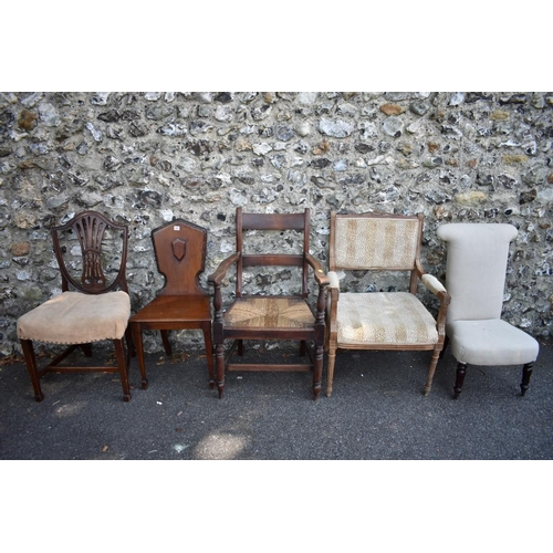 1022 - A Victorian mahogany hall chair; together with four other chairs. <strong>This lot can only be ...