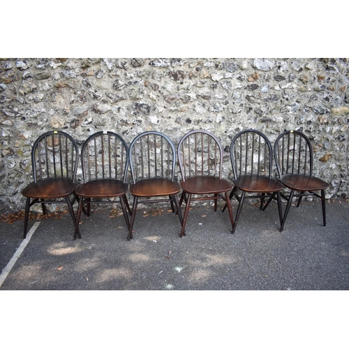 1023 - A set of six dark Ercol stick back dining chairs.<strong>This lot can only be collected on Saturday...