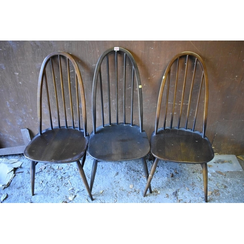 1024 - A set of three dark Ercol highback dining chairs.<strong>This lot can only be collected on Saturday...