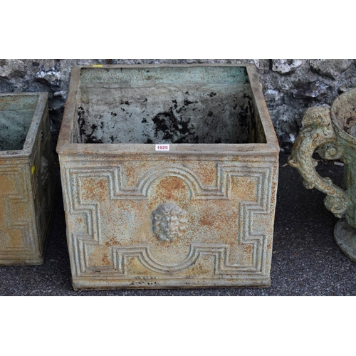 1025 - A pair of fibreglass garden urns; together with three other rectangular examples.<strong>This ...