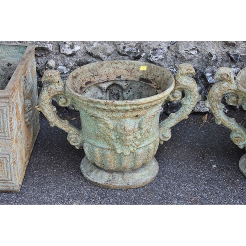 1025 - A pair of fibreglass garden urns; together with three other rectangular examples.<strong> This ...