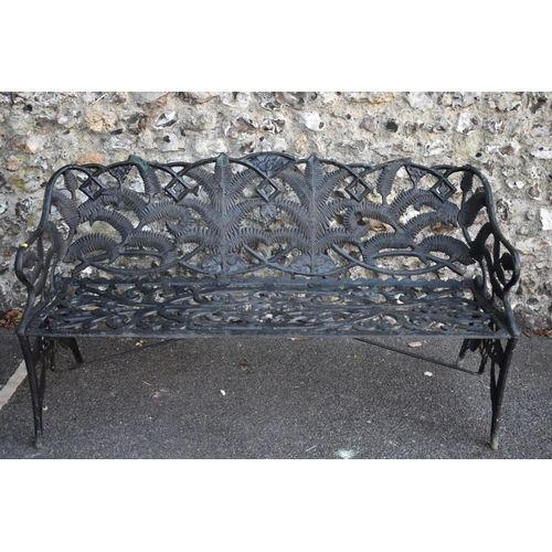 1031 - A black painted steel garden bench decorated stylised ferns and floral scrolls, 153cm wide.<st...
