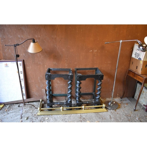1034 - A brass fire kerb, 135cm wide; together with two standard lamps and two table bases.<strong>This lo...