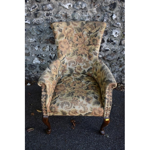 1035 - An early 20th century buttonback armchair having stained beech legs.<strong>This lot can only be co...