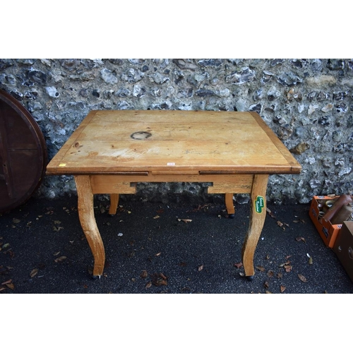 1036 - A continental pine drawleaf table, 198.5cm extended, 81cm wide.<strong>This lot can only be co...