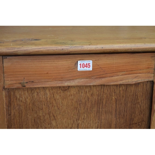 1045 - A pine and other wood pillar cabinet, having shelved interior, 54cm wide x 123cm high; together with...