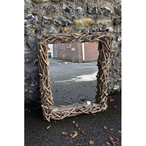 1046 - A modern rectangular wall mirror, having driftwood frame, 93 x 76cm.<strong>This lot can only ...