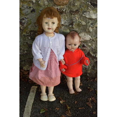 1111 - A Pedigree doll and one other.<strong>This lot can only be collected on Saturday 5th September (10-...