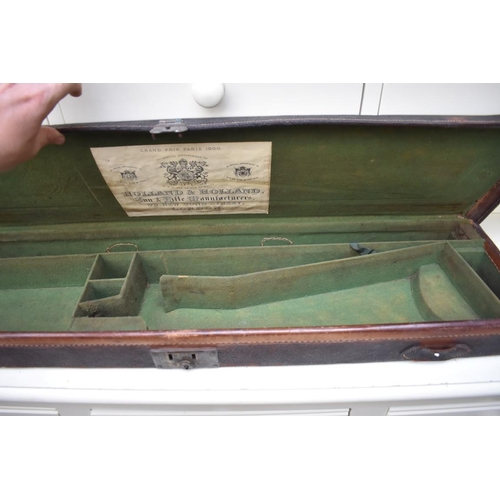 1248 - <strong>Two old shotgun cases, </strong>one with remnants of gun....