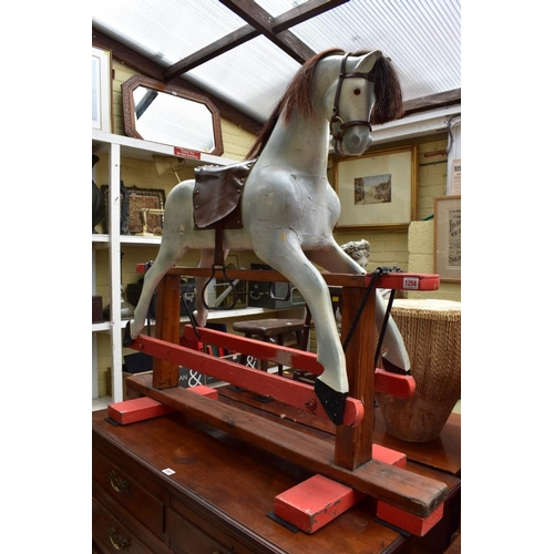 1258 - <strong>An old painted wood rocking horse,</strong> 112cm high....