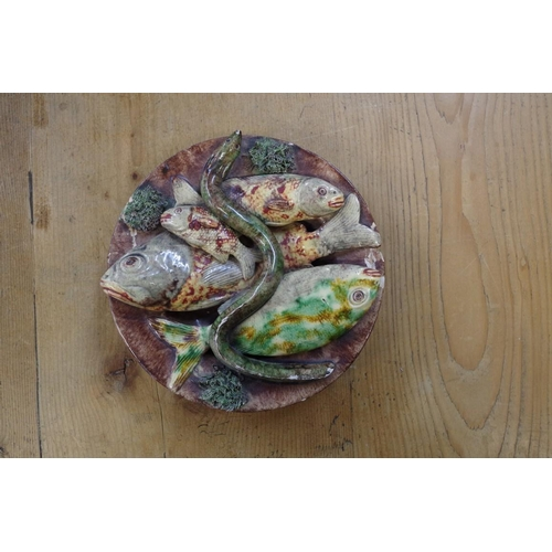1562 - <strong>A pair of Caldas Palissy style majolica plates, </strong>each moulded with fishes and an eel...