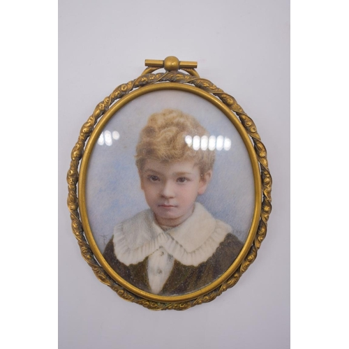 1584 - <strong>A mixed group of items,</strong>to include an Edwardian portrait miniature of a young ...