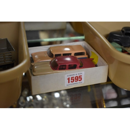 1595 - <strong>Dinky Toys:</strong>two vintage diecast vehicles comprising: Packard Clipper No.180 (cerise...