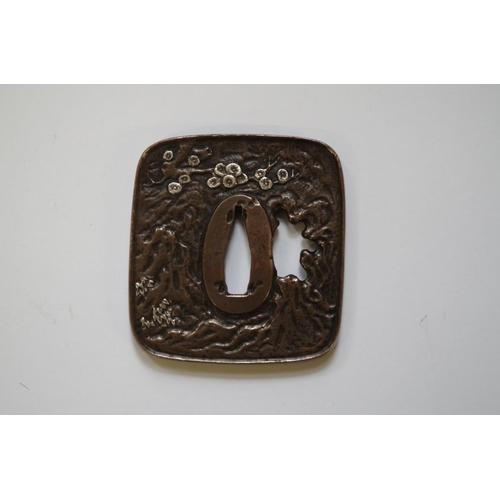 1691 - <strong>A Japanese bronze and silver tsuba,</strong> 7 x 6.5cm....