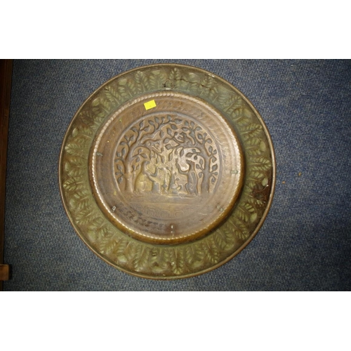 1723 - <strong>A 19th century continental patinated brass alms dish, </strong>embossed to the centre with a...
