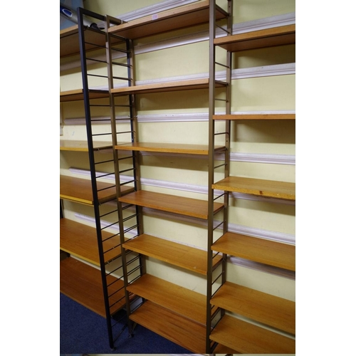 1730 - A vintage Ladderax modular bookcase,93cm wide; together with another similar two column example, 12...