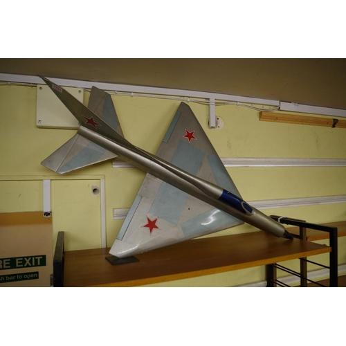 1731 - A vintage painted model of a US jet plane,103cm long.