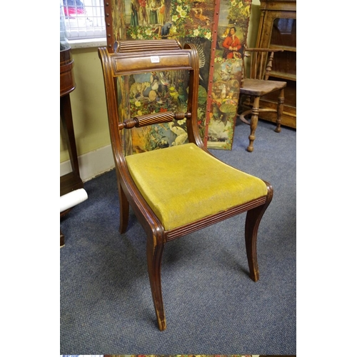 1744 - <strong>A set of six Regency mahogany sabre leg dining chairs,</strong>with ropetwist backs....
