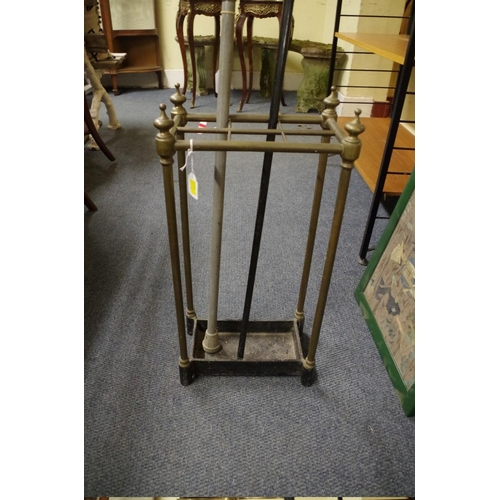 1748 - <strong>A Victorian brass six division stick stand,</strong>61cm wide....