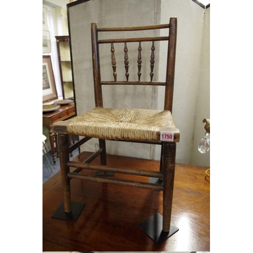 1750 - <strong>A Victorian ash and rush seated child's chair.</strong>...