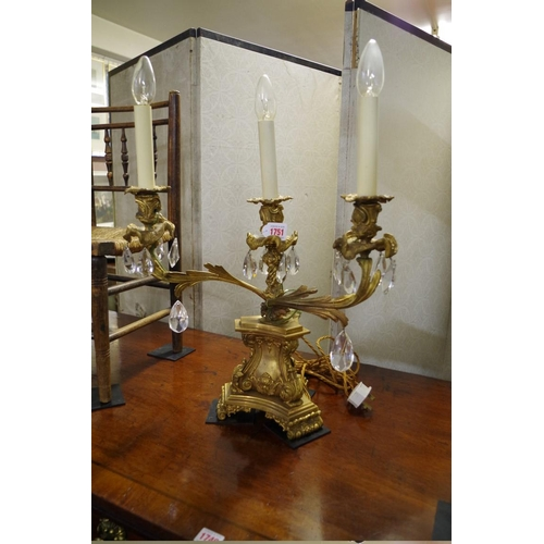 1751 - <strong>An antique cast and gilt brass three light table lamp,</strong>43cm wide....