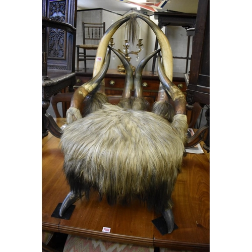 1755 - <strong>Taxidermy:</strong>a novelty buffalo horn and hide chair, 86.5cm high....