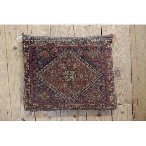 1757 - A Persian saddlebag cushion,32 x 39cm.