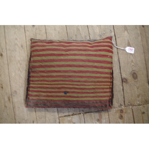 1757 - <strong>A Persian saddlebag cushion, </strong>32 x 39cm. ...