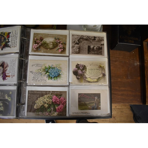1766 - Postcards:an interesting album of two hundred and forty early 20th century postcards, with three ad...