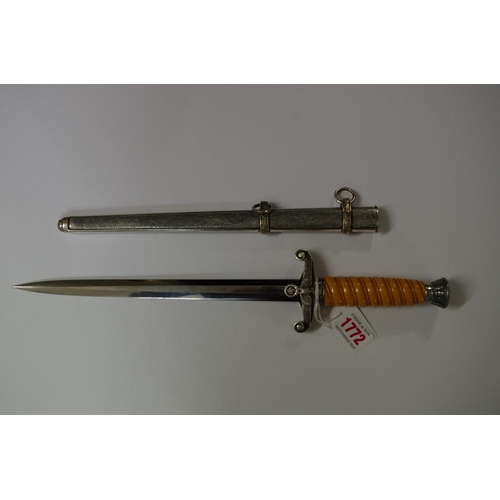 1772 - <strong>A World War II German Heer dagger and sheath,</strong>by Alexander Coppel, Solinger, with 2...