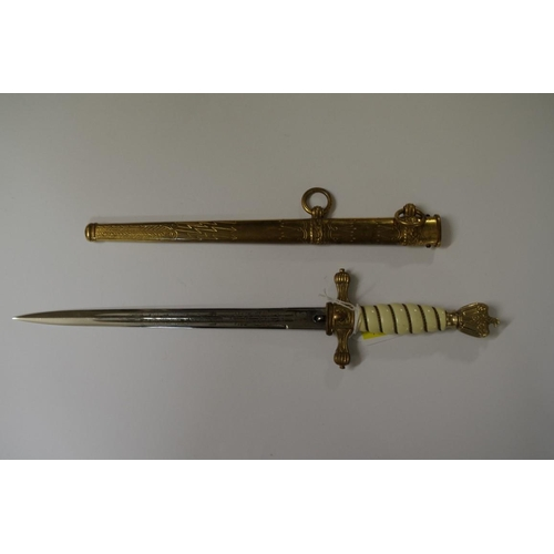 1773 - <strong>A World War II German Kriegsmarine officer's dagger and brass sheath,</strong> by Eickhorn S...