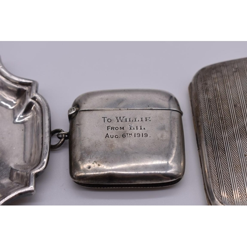 103 - <strong>A small group</strong> <strong>of silver and other metal items, </strong>comprising: a silve...