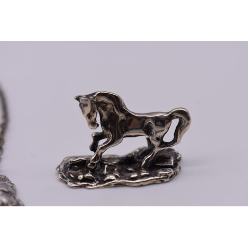 104 - <strong>A small group of silver and EPNS items,</strong> to include: a horse figure, stamped 925; a ...