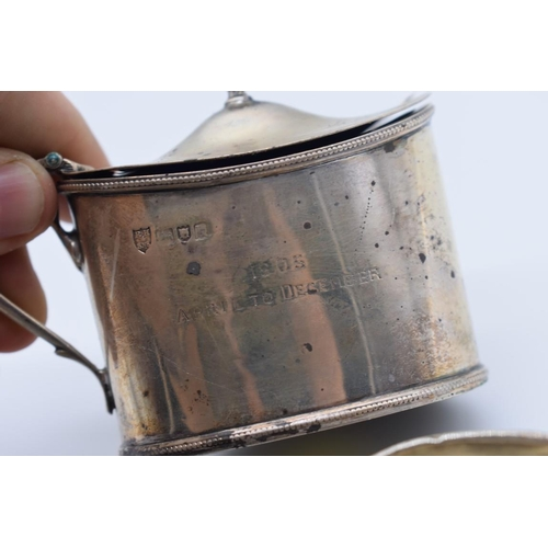 109 - <strong>An Edwardian silver mustard, </strong>by<em> R H Halford & Sons, </em>London 1905, 72g; ...