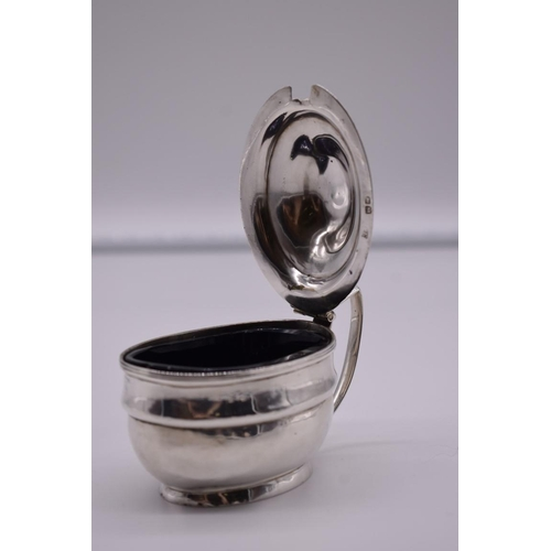 11 - <strong>A George III silver mustard,</strong> by <em>Charles Fox I, </em>London 1807, 8cm high, 101g...